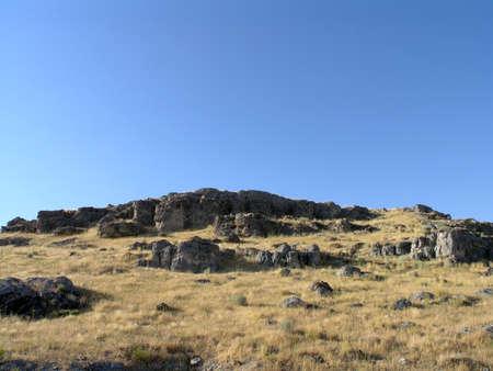rockslide: Rocky Hillside with tall dry grass in Utah.