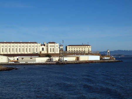 correctional facility: San Quentin State Prison California taken from a passing ferry, San Francisco bay in the foreground.