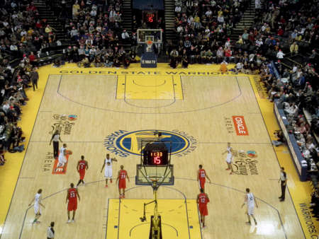 ca he: OAKLAND, CA - DECEMBER 25: Portland Blazers vs. Golden State Warriors: Warriors Monta Ellis dribbles ball around the three point line as other players stand walking to see what he does at the Oracle Arena taken December 25, 2010 Oakland California.