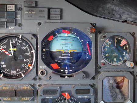 Jet aircraft cockpit Equipment with various indicators, buttons, dials, and instruments.