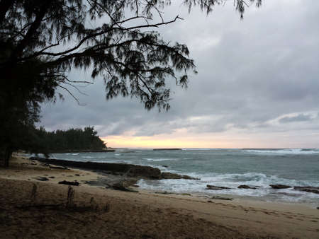 Dusk on Beach as waves break on shore at Kawela Bay on the North Shore of Oahu. photo