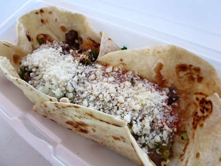 Open Face Steak Burrito in polystyrene Container on Oahu. photo