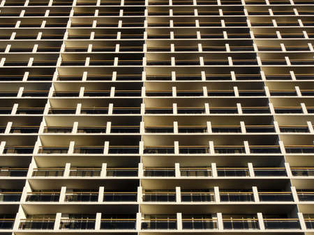 repetitious: Balconies and Windows of Building looking upwards creating a pattern in Oakland, California.