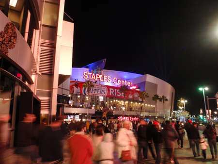 clippers: LOS ANGELES - NOVEMBER 25: Fans enter arena during Clippers game of the 2010-2011 NBA basketball season on November 25, 2010 in Los Angeles. Entrance of the Staples Center at night. It is 950,000 SF and is home to the Clippers and Laker teams and seats up Editorial