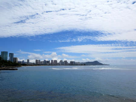 Ala Moana Beach Park with buildings of Honolulu, Waikiki and iconic Diamondhead in the distance during a beautiful day on the island of Oahu, Hawaii. photo