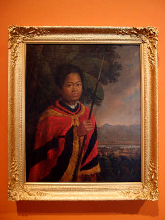destined: Kamehameha III, 1825, Oil on canvas by Robert Dampier (British, 1800-1874).  Posed as the monarch he was destined to become, young Kamehameha stands regally in a verdant setting,  the small settlement of Honolulu fort just visible beyond the banana trees  Editorial
