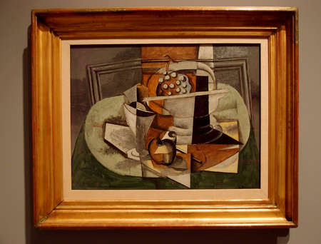 Le Tapis Vert, 1929, Georges Braque -  In this still life, flat planes of neutral color advance and recede against the picture plane, emphasizing its two-dimensionality even as they overlap, merge, and collide to suggest three-dimensional objects arranged