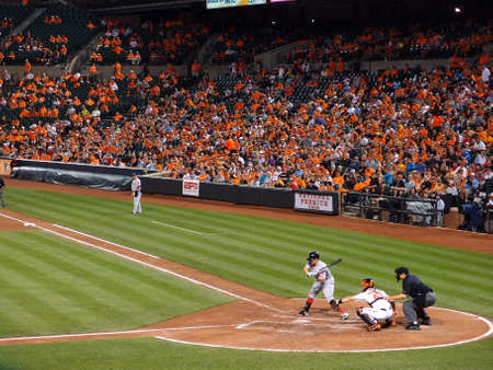 Baltimore, MD - JUNE 11: Red Sox Batter check swing as Orioles catcher catches the pitch with umpire behind him June 11, 2014 in Baltimore, MD.