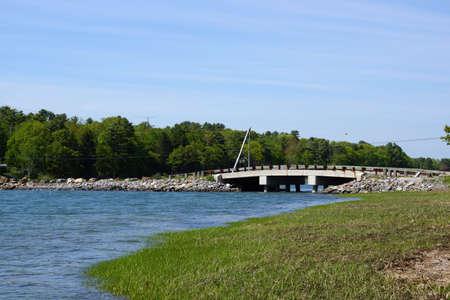 rd: water flows below Talbot Rd. Bridge, Cousins to Littlejohn Island, Yarmouth, Maine.   Stock Photo