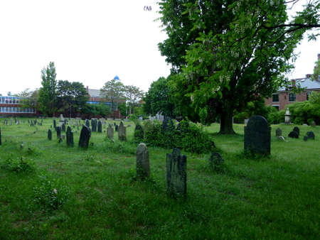 burying: Historic Graveyard, The Burying Point, has been used since 1637, on a overcast wet day in Salem, Masachusetts