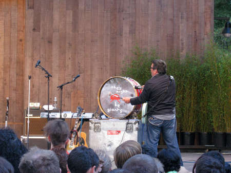 SAN FRANCISCO - AUGUST 22: 73rd Stern Grove Festival: They Might Be Giants member John Flansburgh bang drums stage at a outdoor concert August 22 2010 San Francisco CA. Editorial