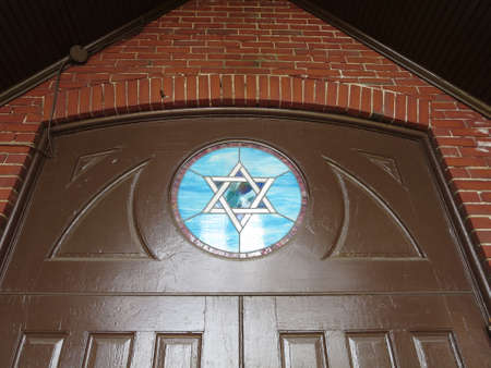 jewish star: Doorway with stain glass Jewish Star at the Maine Jewish Museum - Historic Etz Chaim Synagogue built in the 1920s.  Portland, Maine. Editorial