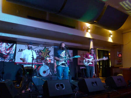 HONOLULU, HI - JULY 12, 2014: Reggae band Guidance Band jams at the Crown in Waikiki, Hawaii.