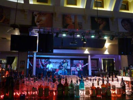 jams: HONOLULU, HI - JULY 12, 2014: Reggae band Guidance Band jams at the Crown, photo from behind bar, in Waikiki, Hawaii. Editorial