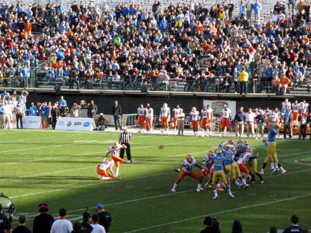 fight hunger: SAN FRANCISCO, CA - DECEMBER 31: Kraft Fight Hunger Bowl: Illinois vs UCLA, Illinois Kicker kicks field goal football at as UCLA players jump to block ball which can be seen flying in the air on Dec. 31, 2011 AT&T Park San Francisco.