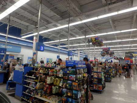 walmart: HONOLULU, HI - JULY 1, 2014:  interior of WalMart department store Checkout aera in Honolulu, USA on July 1,2014. WalMart is world third largest public corporation according to Fortune Global 500 in 2012