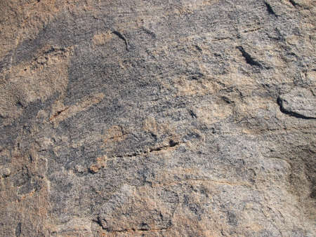 Water worn Stone Rock Close-up with line and cut pattern. Stok Fotoğraf