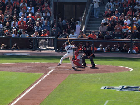 ca he: SAN FRANCISCO, CA - OCTOBER 19: San Francisco Giants vs. Philadelphia Phillies: Buster Posey lifts foot as he prepares to swings at pitch as catcher reaches for ball game three of the NLCS 2010 taken October 19, 2010 AT&T Park San Francisco California.