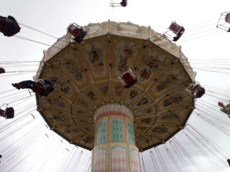 exhilarating: SANTA CLARA - OCTOBER 23: Celebration Swing carousel at Great America Park on October 23, 2010 in Santa Clara, California.  Swings spins you in a 70-foot diameter circle at 9 to 11 revolutions per minute, an exhilarating experience for the whole family.