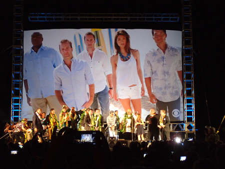 television show: HONOLULU - SEPTEMBER 13: Cast of Hawaii 5-0 Television show season 5 stands on stage during season premier red carpet on Queens Beach in Waikiki, Hawaii September 13, 2014. Editorial