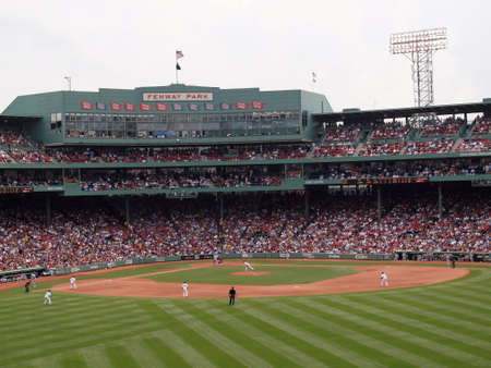 Red Sox vs Athletics: Red Sox Pitcher Tim Wakefield throws a pitch to an Oakland Athletic batter with whole in field in view.  taken June 3, 2010 Fenway Park Boston, Massachusetts from the bleachers .