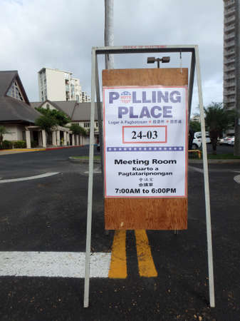 polling: HONOLULU, HI - AUGUST 9: Polling Place Sign outside church in Maikiki in the city of Honolulu, Hawaii on Primary Election day on August 9, 2014.