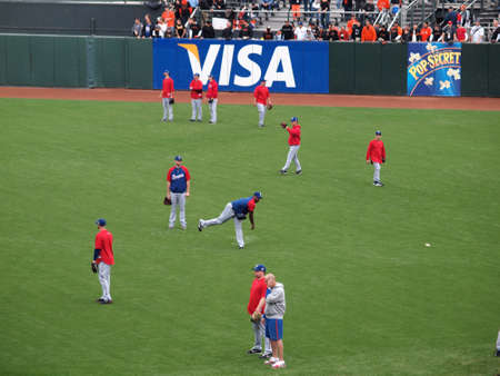 outfield: SAN FRANCISCO, CA - OCTOBER 28: Rangers players warm-up in the outfield during batting practice before the start of game 2 of the 2010 World Series game between Giants and Rangers Oct. 28, 2010 AT&T Park San Francisco, CA.  Editorial