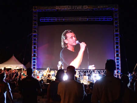 television show: HONOLULU - SEPTEMBER 13: Rock Band Bush plays on stage at night during the Hawaii 5-0 Television show season 5 with screen projecting image of lead singer Gavin Rossdale singing on Queens Beach in Waikiki, Hawaii September 13, 2014. Editorial