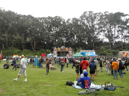 SAN FRANCISCO - SEPTEMBER 24:  Crowd of people talk and drink beer in celebration of bicycling at Tour De Fat concert with stage and trees in the distance taken September 24, 2011 Golden Gate Park San Francisco.