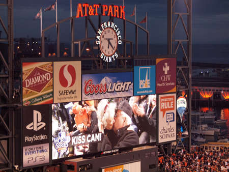 innings: SAN FRANCISCO, CA - OCTOBER 28: Elderly couple make out on Kiss Cam on Scoreboard in between innings of game 2 of the 2010 World Series game between Giants and Rangers Oct. 28, 2010 AT&T Park San Francisco, CA