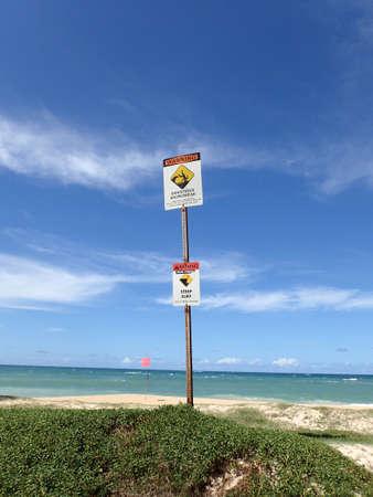 Dangerous shore break and Steep cliff Warning Signs at Baldwin Beach Maui. photo