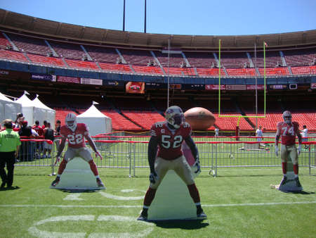 sf: SAN FRANCISCO, CA - JUNE 12: 49er football player cut out stand on field at FanFest to kickoff the new season in one of there last years played at Historic Candlestick Park June 12, 2010 San Francisco, CA.