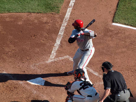 ca he: SAN FRANCISCO, CA - OCTOBER 20: Giants vs. Phillies: Phillies Ryan Howard holds bat on shoulder in the batters box during as he waits for pitch with Buster Posey catching 4 of the NLCS 2010 October 20, 2010 AT&T Park San Francisco