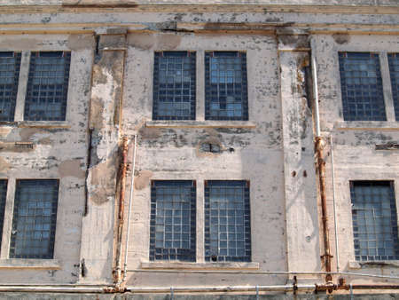 ALCATRAZ PRISON, SAN FRANCISCO, US -  APRIL 9: A view of the prison facilities rusted windows on exterior wall on April 9, 2011 in Alcatraz Island, US. Which was used from 1933 until 1963.