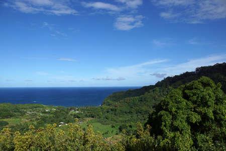 haiku: Lush green valley looking towards the ocean at Wailua Nui Ahupua`a, Haiku, Maui, Hawaii.