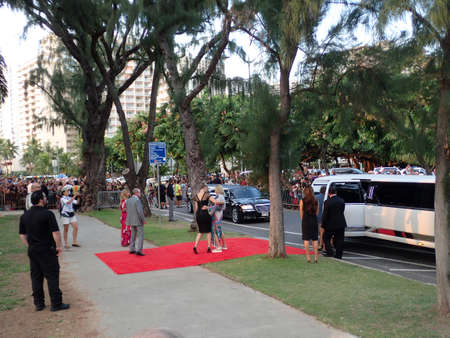 leis: HONOLULU - SEPTEMBER 13: People pose for Red carpet as they exit limos at the Hawaii 5-0 Television show season 5 premier as crowd watches on Queens Beach in Waikiki, Hawaii September 13, 2014.