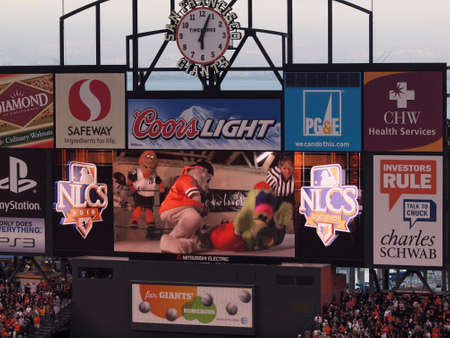 innings: SAN FRANCISCO, CA - OCTOBER 20: Philadelphia Phillies Phanatic vs. San Francisco Giants Lou Seal Mascot fight in wrestling match on scoreboard during innings game four of the NLCS 2010 taken October 20, 2010 AT&T Park San Francisco California. Editorial
