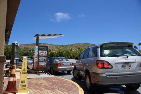happier: HONOLULU - AUGUST 24: Taco Bell drive thru line of cars wait to order food on August 24, 2014 in Hawaii Kai, Hawaii. Editorial