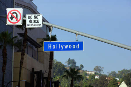splitting: LOS ANGELES, USA - JANUARY 23: Blue and white Hollywood Boulevard street sign on January 23, 2014 in Los Angeles, California.  Hollywood Boulevard is a street in Hollywood, Los Angeles, California, splitting off Sunset Boulevard in the east and running no Editorial