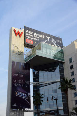 acura: LOS ANGELES - JAN 23: Big Red W and Drais signs with ads for Aziz Ansariand Acura on the side of the Modern W Hotel Hollywood building on famous Hollywood Boulevard on January 23, 2014 in Los Angeles, CA.