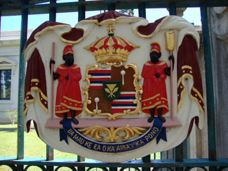 Historic Royal Seal at Iolani Palace one of 16 Bronze Coat of Arms of the government of Hawaii with the state motto: Ua Mau Ke Ea o Ka Aina i ka Pono (The life of the land is perpetuated in rightrousness). Editorial