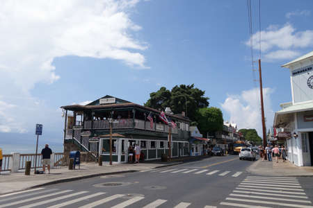 usps: LAHAINA, HI - SEPTEMBER 30: landmark Cheese Burger in Paradise restaurant on the Lahaina waterfront with people exploring the surrounding town on September 30, 2014. Lahaina was once capital of Hawaii and home to the whaling industry. Now it is a pretty t