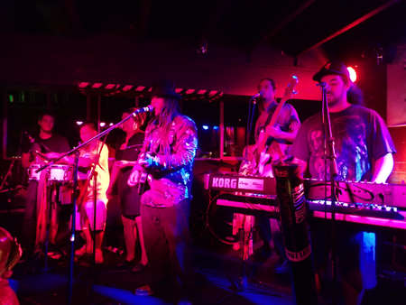 HONOLULU, HI - FEBRUARY 21, 2015: Reggae band Guidance Band jams at the Anna OBriens in Honolulu, Hawaii.