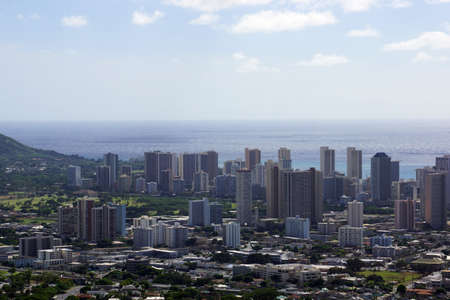 bird       s house: Aerial of  Honolulu, Diamond Head, Waikiki, Buildings, parks, hotels and Condos with Pacific Ocean stretching into the distance on nice day.