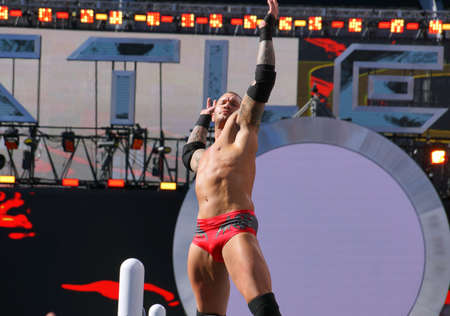 levis: SANTA CLARA - MARCH 29: Close-up of WWE Wrestler Randy Orton does signature pose with arms held in the air on turnbuckle before match at Wrestlemania 31 at the Levis Stadium in Santa Clara, California on March 29, 2015. Editorial