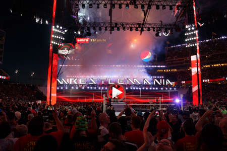 levis: SANTA CLARA - MARCH 29: Fans cheer and record action on phones at close of Wrestlemania 31 as Seth Rollins celebrates championship victory by holding title in the air at the Levis Stadium in Santa Clara, California on March 29, 2015.