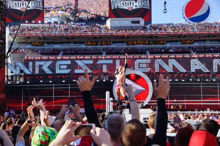 levis: SANTA CLARA - MARCH 29: Randy Orton poses on turnbuckle as fans cheer and record action on phones before match at Wrestlemania 31 at the Levis Stadium in San Clara, California on March 29, 2015.
