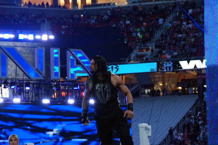 reigns: SANTA CLARA - MARCH 29: Roman Reigns wrestler stands on top turnbuckle before start of championship matchh at Wrestlemania 31 at the Levis Stadium in Santa Clara, California on March 29, 2015. Editorial