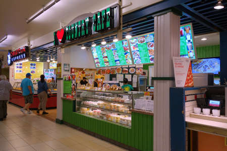striving: HONOLULU - December 12, 2014:  I Love Country Cafe and Chinatown Express at the Honolulu Ala Moana Center food court. Since opening in 1987, I Love Country Cafe has been constantly striving for excellence.   on December 12, 2014. Editorial
