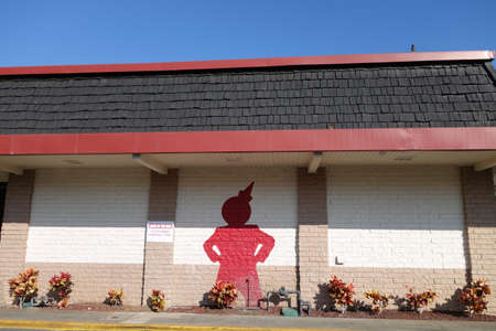 jack in a box: HONOLULU - JANUARY 18, 2015: Jack in the Box Restaurant exterior with a Red Jack painted on the side of the building. Jack in the Box is an American fast-food restaurant chain with 2,200 locations, serving the West Coast of the United States on January 18 Editorial